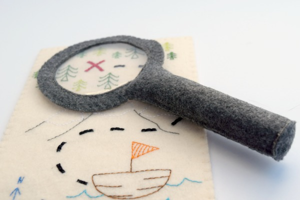 magnifying glass and treasure map
