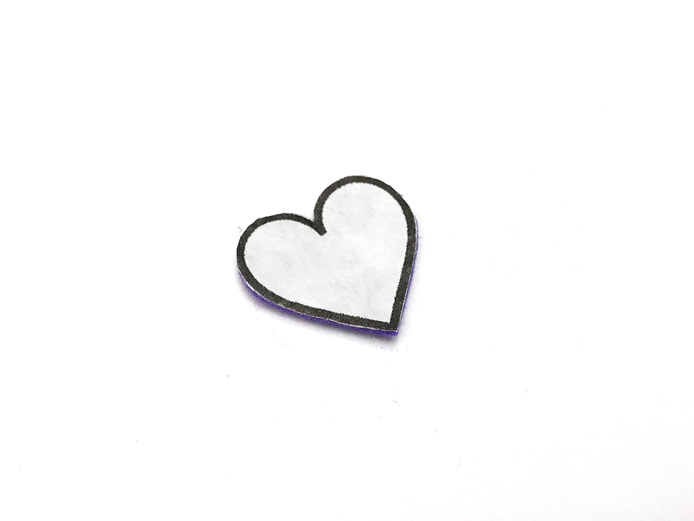 The Secret to Cutting Perfect Felt Shapes - cut out heart with freezer paper attached